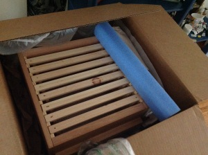 "Each of the three hive boxes contains eight bars, coated with beeswax, and perfectly spaced to conform to ""bee space""."